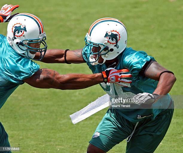 Safety Yeremiah Bell, left, and cornerback Will Allen tangle during drills at Nova Southeastern University in Davie, Florida, Sunday, Juen 8, 2008.