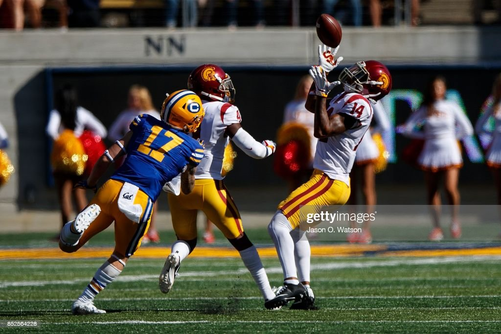 Safety Ykili Ross #14 of the USC Trojans intercepts a pass intended for wide receiver Vic Wharton III #17 of the California Golden Bears during the fourth quarter at California Memorial Stadium on September 23, 2017 in Berkeley, California. The USC Trojans defeated the California Golden Bears 30-20.