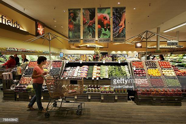 Safeway customer browses in the fruit and vegetable section at Safeway's new 'Lifestyle' store July 18 2007 in Livermore California Safeway unveiled...