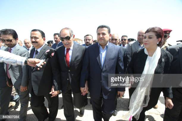 Safeya Sheil Iraqi ambassador to Jordan Qasim alAaraji Iraqi interior minister Ghaleb alZoabi Jordanian interior minister and Erfan alHiyali attend a...