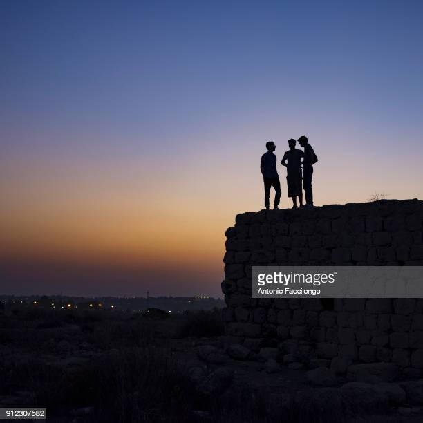 Saffa A group of young Palestinians watch the sunset from above the Roman ruins Young Palestinians observe the sunset with their eyes turned to the...