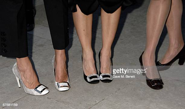 Saffron Aldridge and guests show their Roger Vivier shoes at the store launch party for Roger Vivier in London at the Orangery on May 10 2006 London...