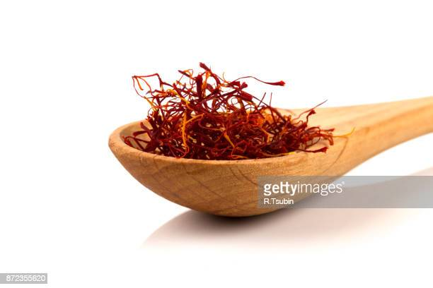 Saffron spice in wooden spoon
