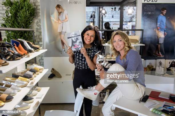 Safia Minney and actress Sanny van Heteren pictured with the fair shoe collection from 'Pozu' at Greenshowroom / Ethical Fashion Show Berlin trade...