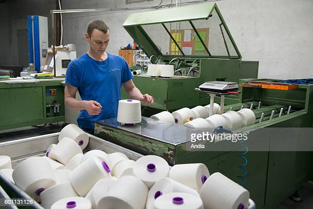 Safilin company specialized in flax weaving in Szczytno Poland Man working in a spinning mill checking the weight of reels