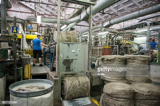 Safilin company specialized in flax weaving in Szczytno Poland Woman working in a spinning mill