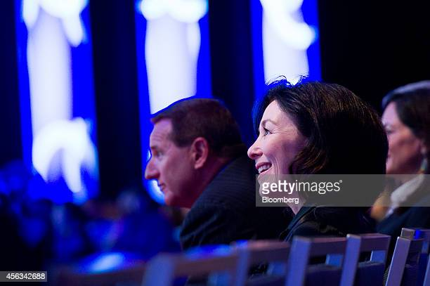 Safra Catz cochief executive officer of Oracle Corp right and Mark Hurd cochief executive officer of Oracle Corp listen to a keynote session during...
