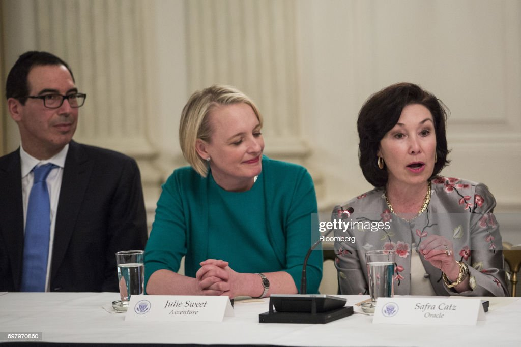 Safra Catz, co-chief executive officer of Oracle Corp., right, speaks as Julie Sweet, chief executive officer of North America at Accenture PLC, center, and Steven Mnuchin, U.S. Treasury secretary, listen during the American Technology Council roundtable hosted at the White House in Washington, D.C., U.S., on Monday, June 19, 2017. Executives from many of the world's largest technology companies gathered for the first meeting of the American Technology Council with U.S. President Donald Trumpand his senior advisers. Photographer: Zach Gibson/Bloomberg via Getty Images