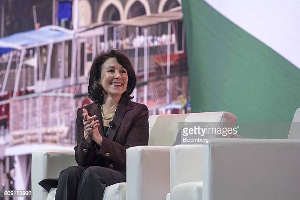 Safra Catz cochief executive officer of Oracle Corp smiles during the Oracle OpenWorld 2016 conference in San Francisco California US on Tuesday Sept...