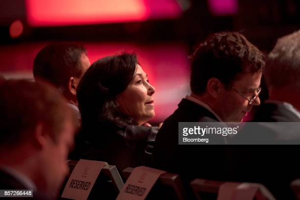 Safra Catz cochief executive officer of Oracle Corp watches a presentation during the Oracle OpenWorld 2017 conference in San Francisco California US...