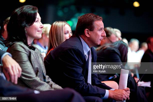 Safra Catz left and Mark Hurd right both copresidents of Oracle Corp listen to Larry Ellison chief executive officer of Oracle Corp speak at the...