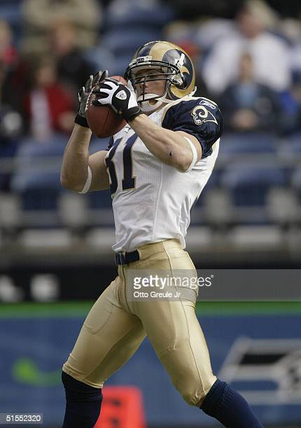 Saftey Adam Archuleta of the St Louis Rams catches the ball during the game with the Seattle Seahawks at Qwest Field on October 10 2004 in Seattle...