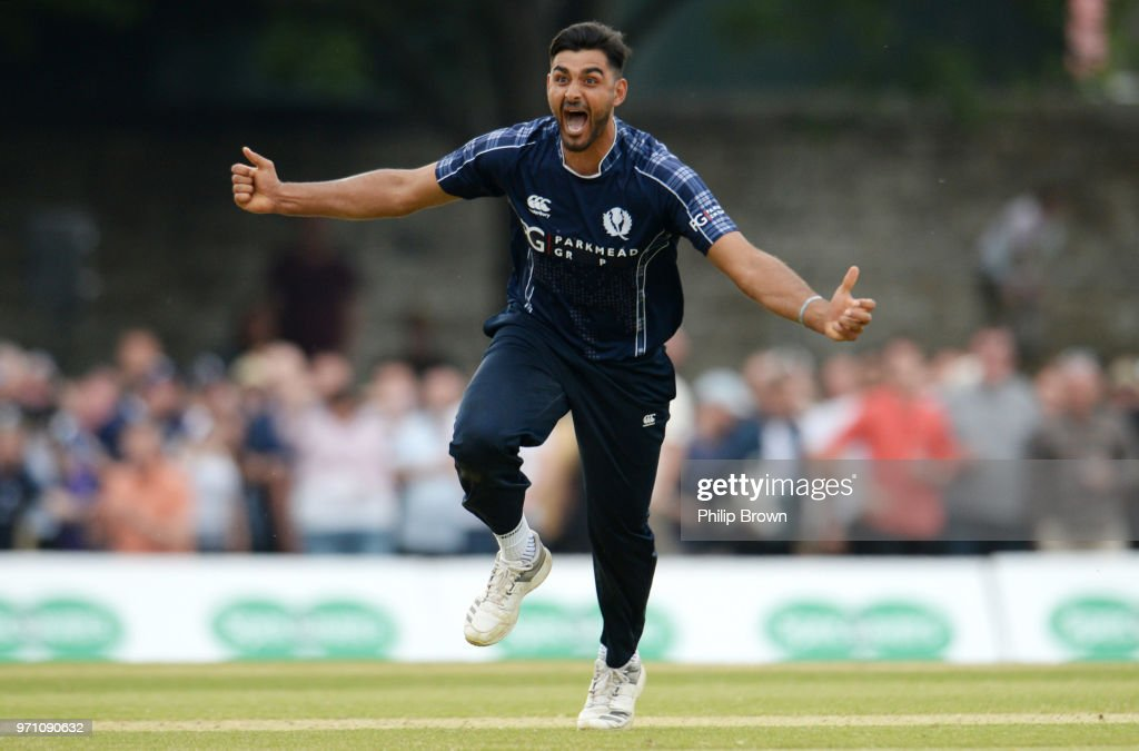 Safyaan Sharif celebrates after taking the final wicket of Mark Wood as Scotland win the One-Day International match between Scotland and England at Grange cricket club ground on June 10, 2018 in Edinburgh, Scotland.