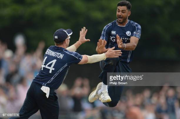 Safyaan Sharif celebrates after taking the final wicket of Mark Wood as Scotland won the OneDay International match between Scotland and England at...