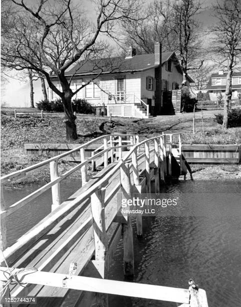 John Steinbeck's summer home in Sag Harbor, New York, showing some of the grounds, the water and the dock in foreground, photographed on March 21,...