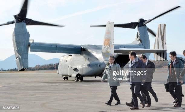 Saga Deputy Gov Hideo Ikeda leaves a Japanese Ground SelfDefense Force camp in Mashiki Kumamoto Prefecture on Dec 13 after taking a flight on a US...
