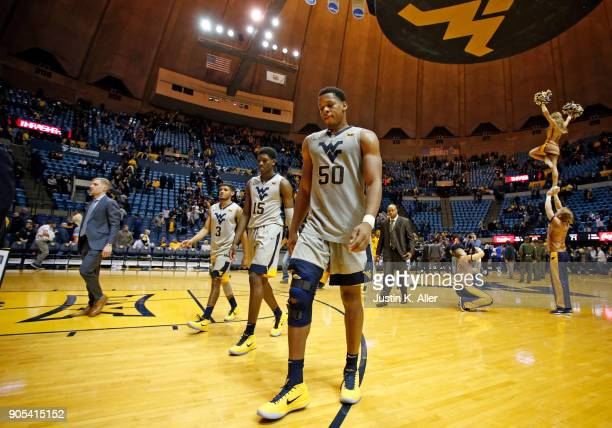 Sagaba Konate Lamont West and James Bolden of the West Virginia Mountaineers walk off the court after losing to Kansas 7166 at the WVU Coliseum on...
