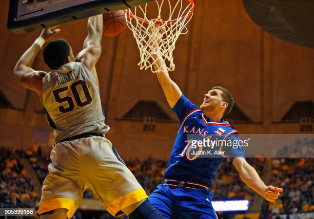 Sagaba Konate of the West Virginia Mountaineers blocks the shot of Sviatoslav Mykhailiuk of the Kansas Jayhawks at the WVU Coliseum on January 15...