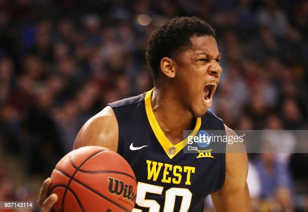 Sagaba Konate of the West Virginia Mountaineers celebrates rebounding the ball during the first half against the Villanova Wildcats in the 2018 NCAA...