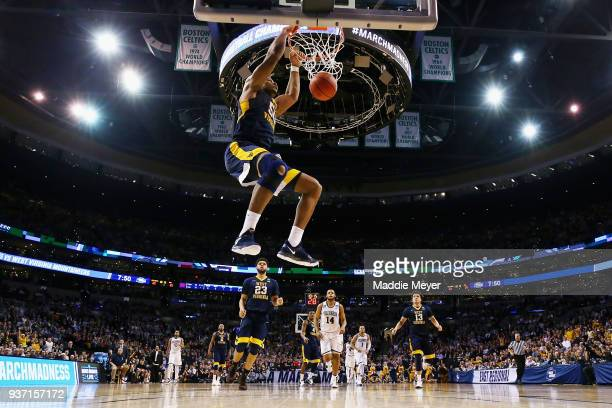 Sagaba Konate of the West Virginia Mountaineers dunks the ball during the first half against the Villanova Wildcats in the 2018 NCAA Men's Basketball...