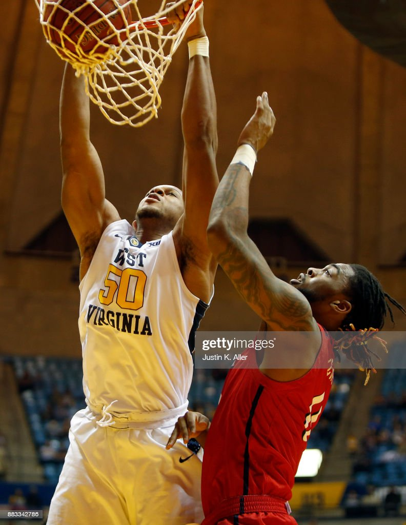 Sagaba Konate #50 of the West Virginia Mountaineers dunks the ball against Mohamed Bendary #34 of the N.J.I.T Highlanders at the WVU Coliseum on November 30, 2017 in Morgantown, West Virginia.