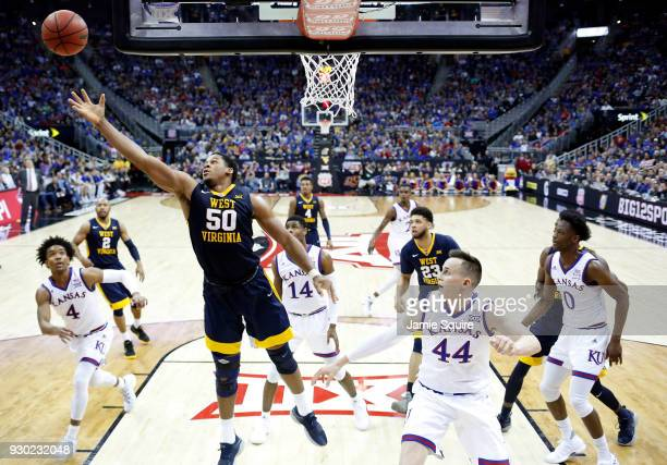 Sagaba Konate of the West Virginia Mountaineers stretches for a rebound during the Big 12 Basketball Tournament Championship game against the Kansas...