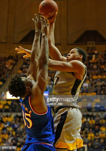Sagaba Konate of the West Virginia Mountaineers takes a shot over Udoka Azubuike of the Kansas Jayhawks at the WVU Coliseum on January 15 2018 in...