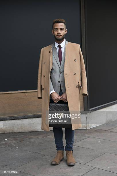 Sagaboi publicist Lawrence Booker wears a Chanel bag Margiela coat Etro blazer Top Man trousers Clerks boots and a Theory shirt and tie day 1 of...