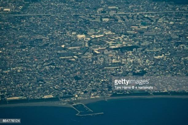 Sagami Bay and center of Chigasaki city in Kanagawa prefecture daytime aerial view from airplane