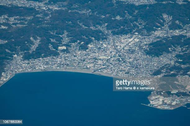 Sagami Bay and center of Kamakura city in Kanagawa prefecture in Japan daytime aerial view from airplane
