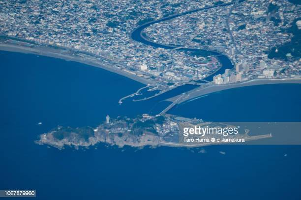 Sagami Bay and Enoshima Island in Fujisawa city in Kanagawa prefecture in Japan daytime aerial view from airplane