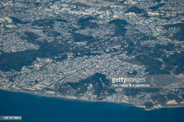 Sagami Bay, and Kamakurayama and Shichirigahama area in Kamakura city in Kanagawa prefecture in Japan daytime aerial view from airplane
