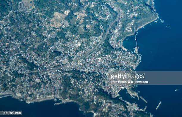 Sagami Bay, and Manazuru and Yugawara towns in Kanagawa prefecture in Japan daytime aerial view from airplane
