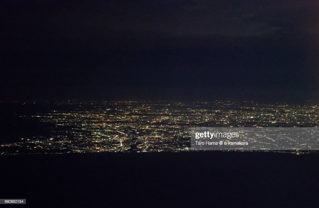 Sagami Bay and Shonan coastline in Kanagawa prefecture in Japan night time aerial view from airplane : ストックフォト