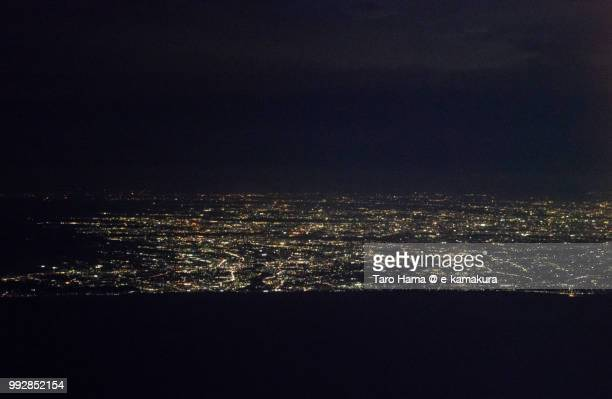 sagami bay and shonan coastline in kanagawa prefecture in japan night time aerial view from airplane - 平塚市 ストックフォトと画像