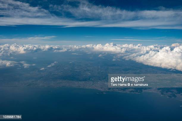 Sagami Bay, and the coastline of Zushi, Kamakura, Fujisawa, Chigasaki and Hiratsuka in Kanagawa prefecture in Japan daytime aerial view from airplane