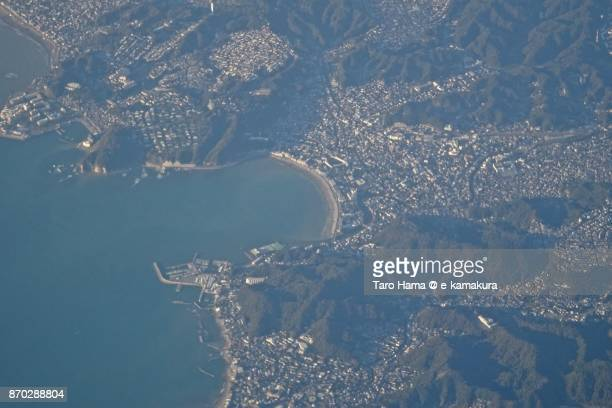 sagami bay and zushi city in kanagawa prefecture daytime aerial view from airplane - zushi kanagawa stock photos and pictures