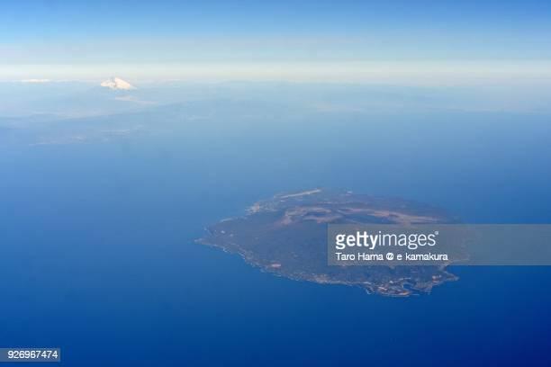 sagami bay, izu peninsula, snow-capped mt. fuji, oshima island in tokyo in japan daytime aerial view from airplane - 太平洋 ストックフォトと画像