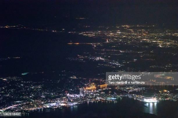 Sagami Bay, Tokyo Bay, and Yokosuka, Kamakura and Fujisawa cities in Kanagawa prefecture in Japan night time aerial view from airplane