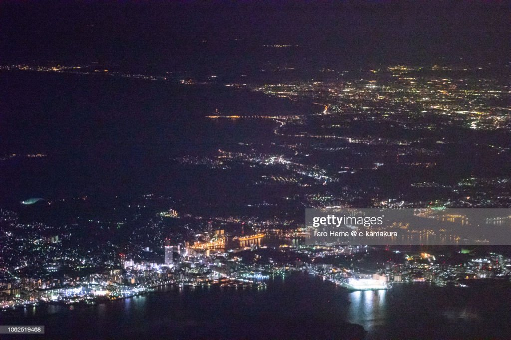 Sagami Bay, Tokyo Bay, and Yokosuka, Kamakura and Fujisawa cities in Kanagawa prefecture in Japan night time aerial view from airplane : ストックフォト