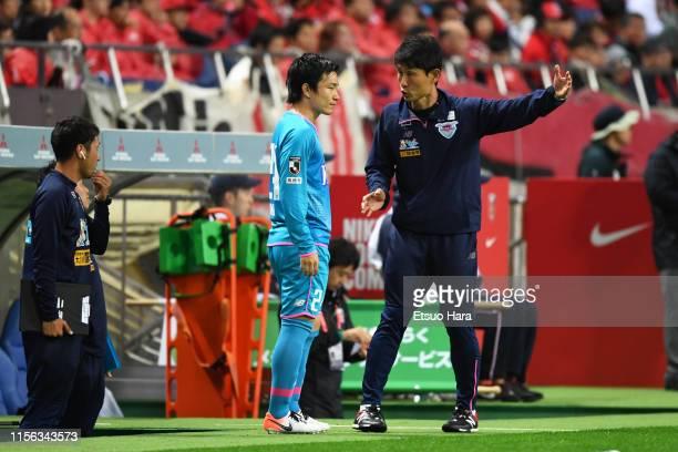 Sagan Tosu head coach Kim Myung Hwi gives instruction to Kazuki Anzai during the J.League J1 match between Urawa Red Diamonds and Sagan Tosu at...