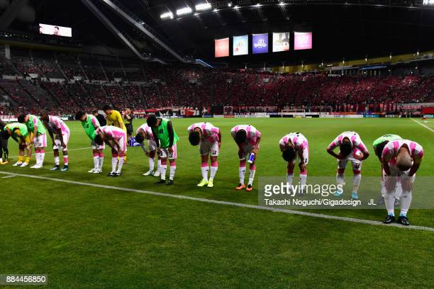 Sagan Tosu players applaud supporters after their 23 defeat in the JLeague J1 match between Consadole Sapporo and Sagan Tosu at Sapporo Dome on...