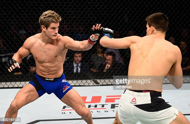 Sage Northcutt and Mickey Gall touch gloves in their welterweight bout during the UFC Fight Night event inside the Golden 1 Center Arena on December...