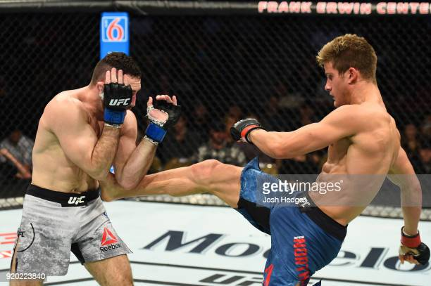 Sage Northcutt front kicks Thibault Gouti of France in their lightweight bout during the UFC Fight Night event at Frank Erwin Center on February 18...