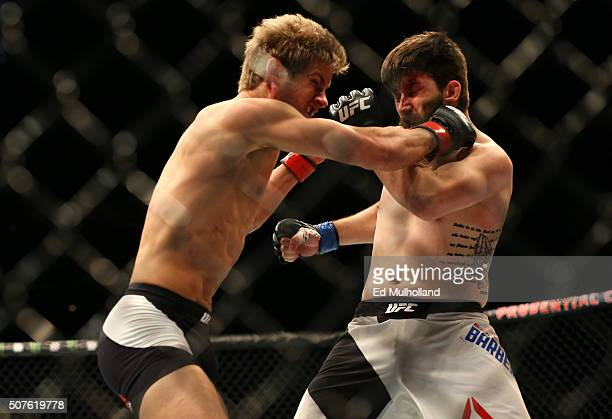 Sage Northcutt punches Bryan Barberena in their welterweight bout during the UFC Fight Night event at the Prudential Center on January 30 2016 in...