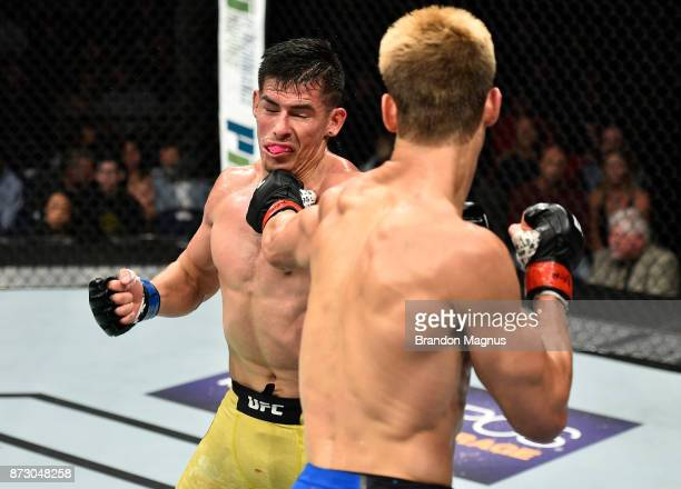 Sage Northcutt punches Michel Quinones in their lightweight bout during the UFC Fight Night event inside the Ted Constant Convention Center on...