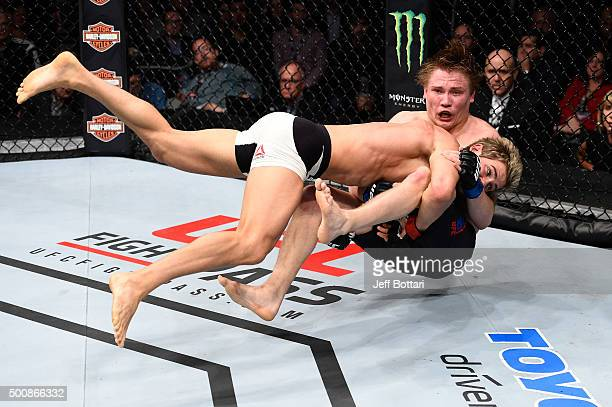 Sage Northcutt takes down Cody Pfister in their lightweight bout during the UFC Fight Night event at The Chelsea at the Cosmopolitan of Las Vegas on...