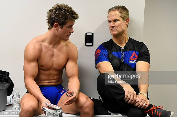Sage Northcutt talks with father and coach Mark Northcutt in his locker room after his loss to Mickey Gall during the UFC Fight Night event inside...