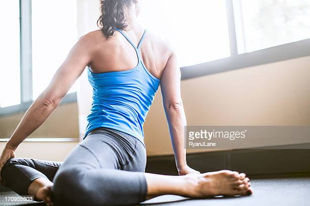 Sage Pose in Yoga Studio