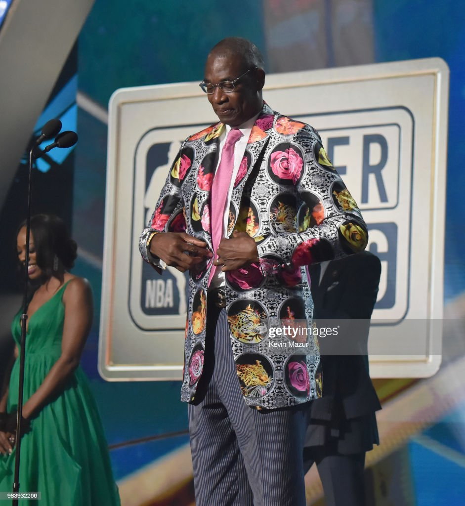 Sager Strong award winner Dikembe Mutombo accepts his jacket from Reggie Miller, Yvonne Orji, and Joel Embiid onstage at the 2018 NBA Awards at Barkar Hangar on June 25, 2018 in Santa Monica, California.